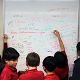 students making notes on whiteboard