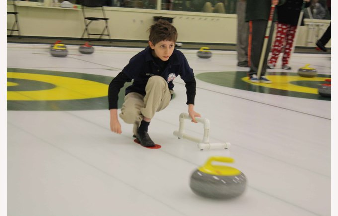 A middle school student plays curling