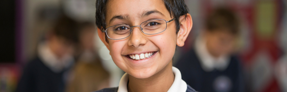 A student smiles at the British International School of Boston, a private school in Boston.