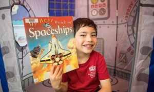 Reception student inside the rocket ship