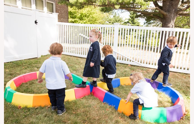 Toddlers playing outside