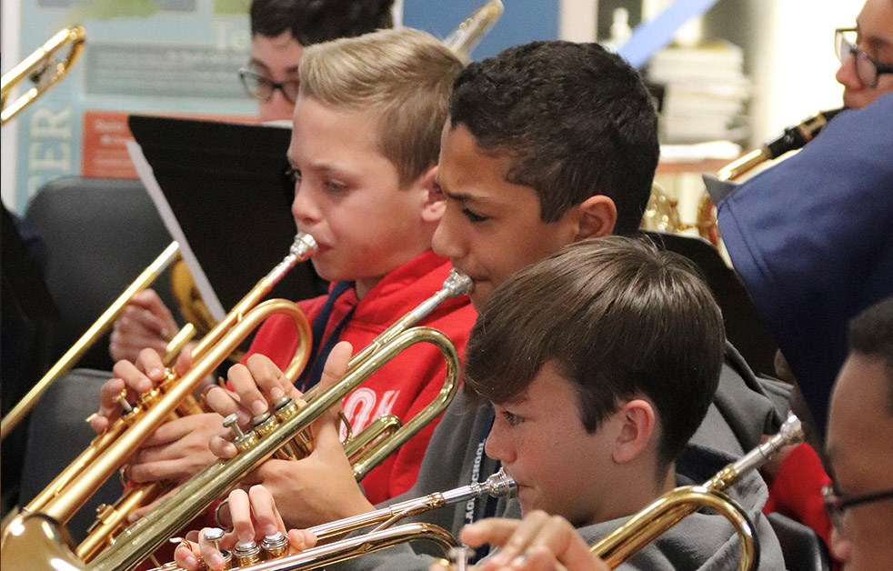 Boys playing brass instruments