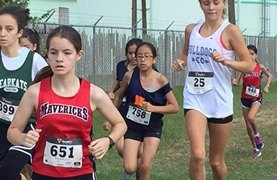 BISH students competing in cross country competition.