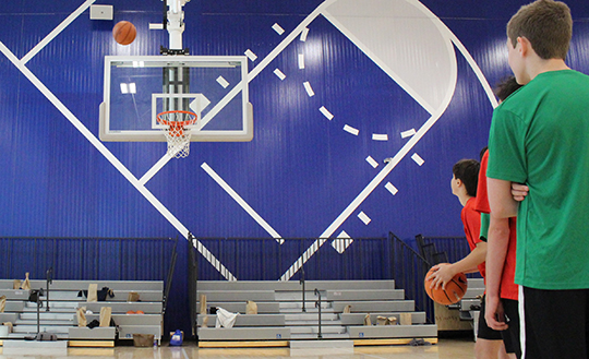 Students shoot baskets at the St. James sports complex.