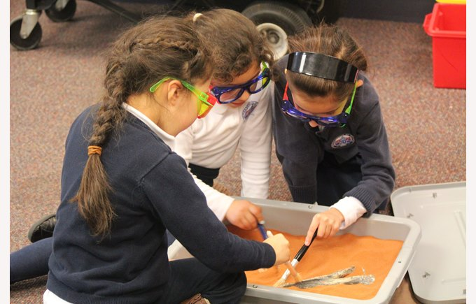 Students examine a fossil