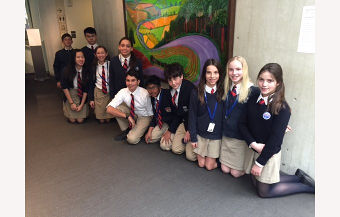 "Students pose in front of David Hockney's ""Garrowby Hill"" at the Boston Museum of Fine Arts"
