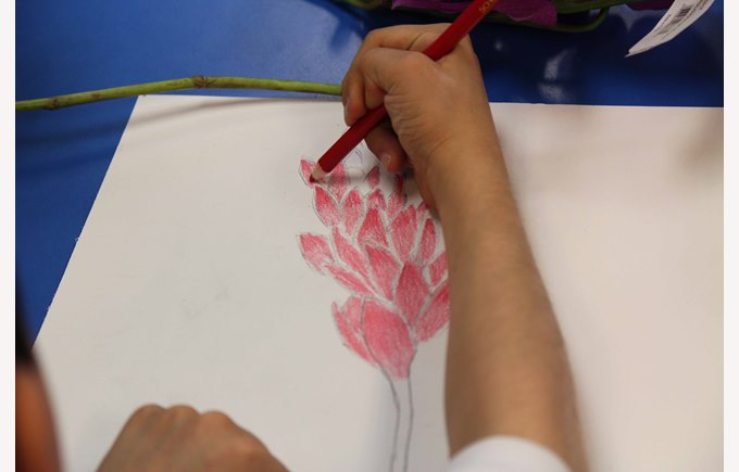 A student draws a picture of a flower