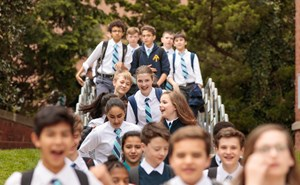 BISW Private British International School of Washington in DC large amount of students walking into school