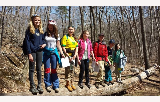 Students pose for a picture during a hike