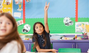 KS2 girl raising hand at the British International School of Chicago, South Loop
