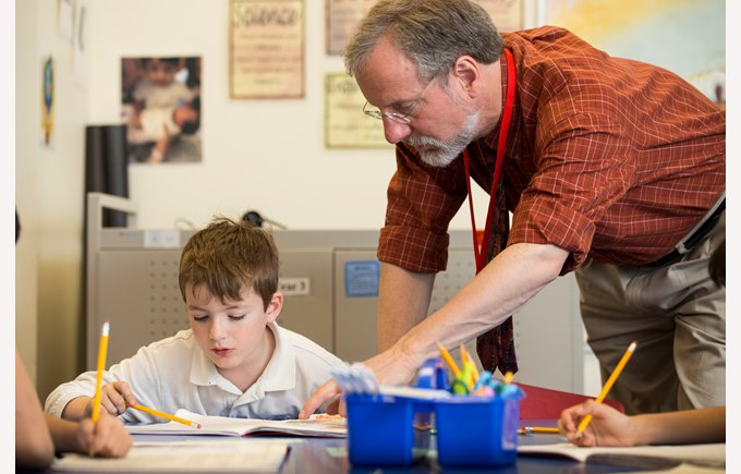 A learning assistant works with a student