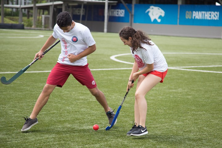 Girl and boy playing hockey