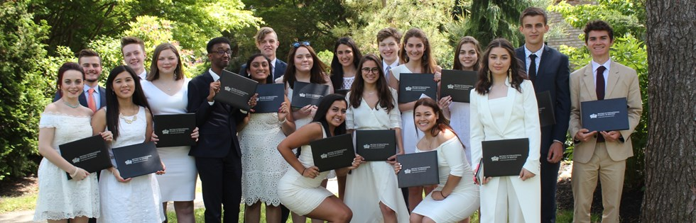 2017 Graduates pose with their diplomas