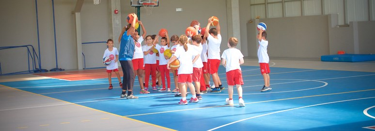 Teacher and students playing a ball game