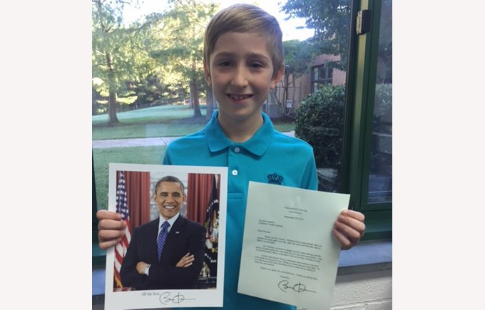 Nicholas with letter and photo