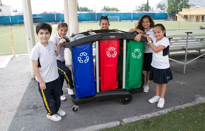 Students with recycling bin