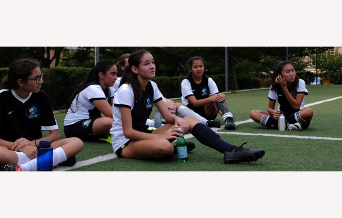 BISW Private British International School of Washington in DC girls varsity soccer team plan their winning game strategy.