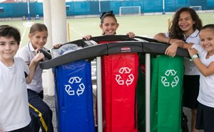 Students with recycling bins