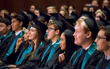 BISW British International School of Washington DC 2019 graduates listen to a graduation speaker.