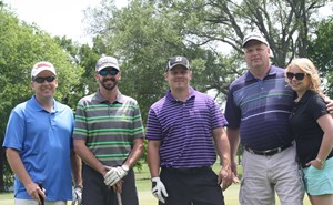 Participants at The Village School's annual golf tournament