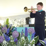 Year 6 boys plays the National Anthem on the trumpet