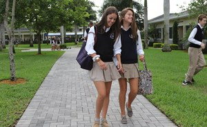 Female students walking across campus