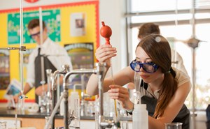 IB student in science lab