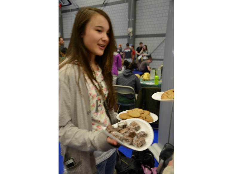 A British International School of Boston student shows off brownies made with locust flour.