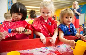 Three early years students playing