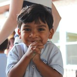 A student smiles for the camera
