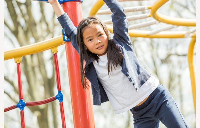 A young girl plays on the playground