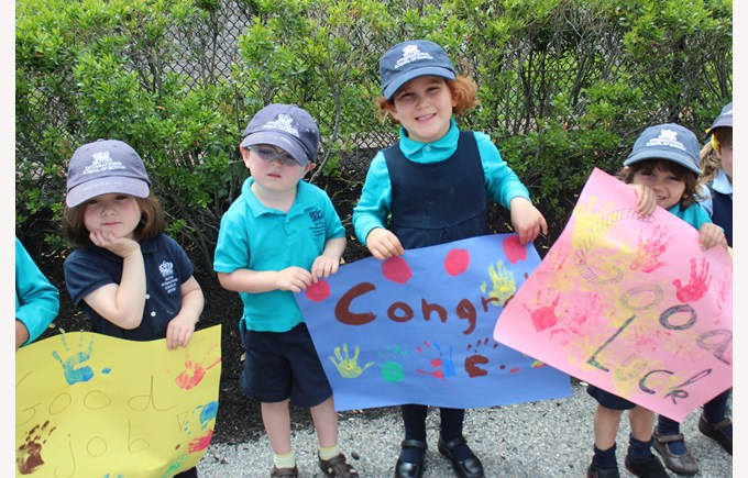 Nursery students congratulating the Seniors