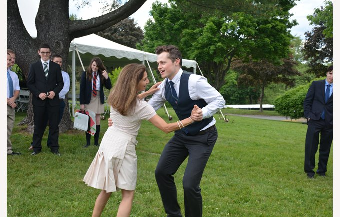 A teacher swing dances