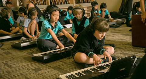Students playing keyboard