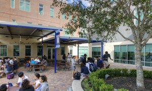 Students sitting in our high school patio
