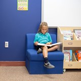 Child in Library reading