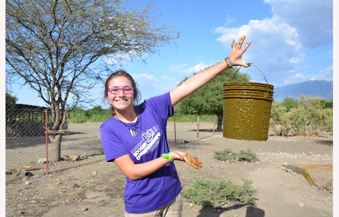 A student smiles while doing service work in Tanzania, Africa.