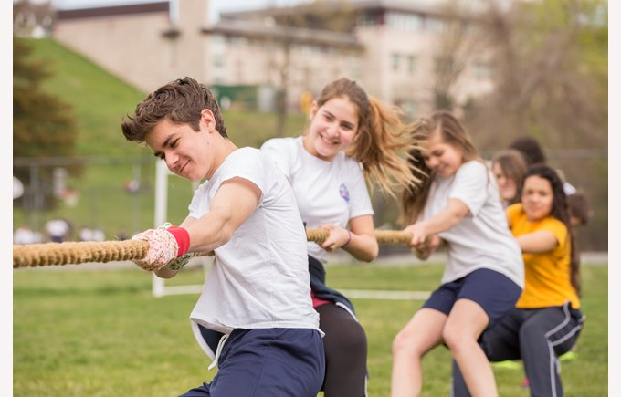 high school students playing tug-of-war
