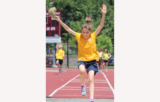 A student competes in a track event