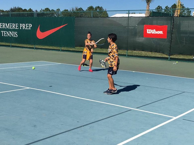 Students playing tenis at the Global Games